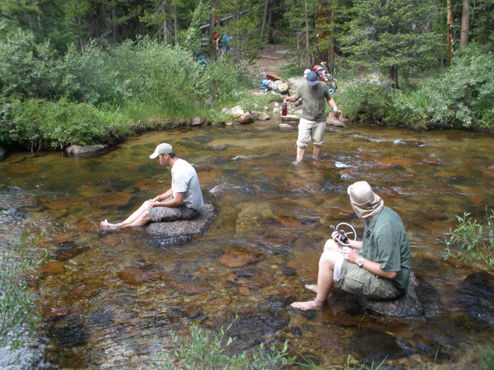 The Professor, Alces, and Photoman Cooling Hot Tired feet at a river crossing.