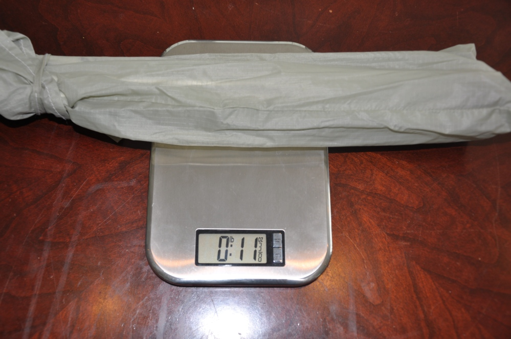 Aluminum poles in bag weigh 11 ounces.